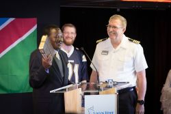 Walvis Bay, Namibia :: Namibia's Vice-President, Dr Nickey Iyambo, accepts a Bible from the Captain of Logos Hope, Tom Dyer (USA).