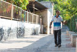 A man walks along a street in Israel.