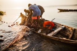 Fisherman on the shore of Lake Tanganyika. OM reaches out to some of the most inaccessible villages in the area.