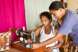 OMer Hermonie, right, instructs one of her sewing students. Hermonie teaches Perle, a Freedom Challenge project in the south of Madagascar that teaches women sewing and cooking skills.