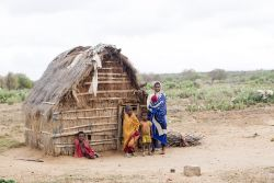 A family stands outside their home in the Androy region in Madagascar.