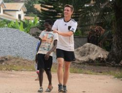 Lukas Schultz serving as a sports coach in Ghana