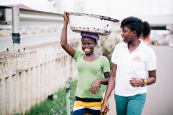 Portia, an OMer from Ghana, walking with one of the Kayeye ladies that she ministers to.