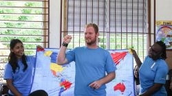 Scarborough, Trinidad  Tobago :: Nancy Bhagat (East Asia Pacific), Wynand Scholtz (South Africa), Glory Seruhere (Tanzania) introduce their names with sign language at a school for deaf children.