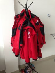 Jackets worn by OM staff and volunteers to serve refugees in Serbia, waiting to be washed.