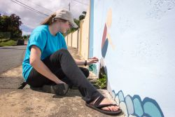 Scarborough, Trinidad  Tobago :: Amy Strickland (US) paints a mural at a childrens home.