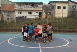 Agape FC, the football club in Brazil?s Jardim Telespark, started over two years ago as a way for former professional player and OMer Mafe Campos to share Jesus? love with the community. Today, the project provides tri-weekly trainings for around 150 six- to 17-year-old boys. A volunteer shares a devotion at each practice. Photo by Nicole James.