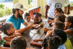 Oranjestad, Aruba :: Children at a Christian youth club listen intently as Karsten Hassman (Spain) uses a deck of cards to tell stories and teach Bible lessons.