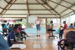 Kingston, Jamaica :: Stein Nilsen (Norway) explains a drama to children with disabilities at a Mustard Seed Communities care facility.