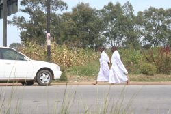 Members of the Vapostori sect walking barefooted
