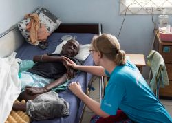 Montego Bay, Jamaica :: Silke Arthasana (Germany) prays for a patient at Hope Hospice in Montego Bay.