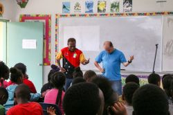 Freeport, The Bahamas :: Collin Kepas (Papua New Guinea) and Nate Johnson (USA) perform a drama during a visit to a police summer camp for children.