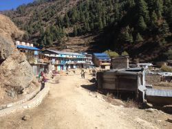 A remote village surrounded by mountains in South Asia.