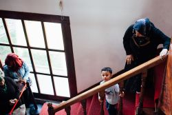 A woman and young boy make their way down the steep stairs at a refugee centre in Turkey.