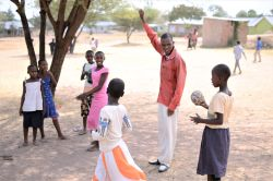Girls playing dodgeball during childrens ministry day at church in Bundu