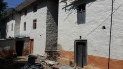 Typical rural village houses in South Asia made from mud and stone and painted with different colours using locally found resources.