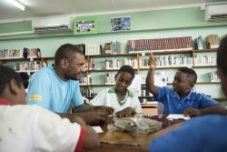 Vieux Fort, Saint Lucia :: Schoolchildren ask Ofasia Wayne (Papua New Guinea) questions about the Bible at an outreach in a village library.