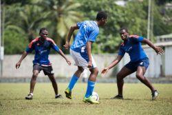 Castries, St. Lucia :: Crewmembers play football against a local team.