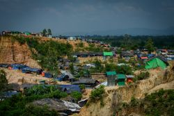 An overview of a Rohingya refugee camp in Bangladesh, showing temporary shelters and bathrooms.  Photo by Garrett N