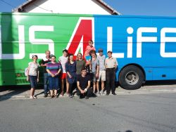 Bus4Life outreach team pictured with local volunteers in Murfatlar, Romania. Bus4Life driver of four years, Esa Tuuri (FIN) is on the right.