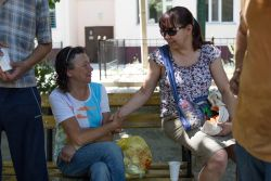 A local believer distributes food to a homeless woman during a weekly outreach in Central Asia.