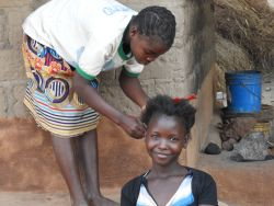 A girl gets her hair braided in Kapembwa, Zambia.