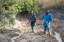 OMer John (right) with one of his disciples as they work the ground to make bricks.