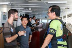 Coatzacoalcos, Mexico :: Karsten Hassman (Spain), Director Pil-Hun Park (South Korea) and the Mayor of Coatzacoalcos talk on the bridge as Logos Hope arrives in port.