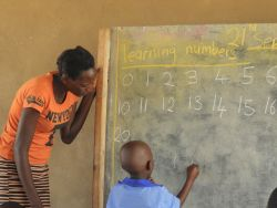 A students works on learning his numbers at Good News II Orphan School.