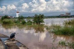 The Mekong River in Vientaine, Laos. The beach and homes in the river are completely or mostly submerged due to flooding.