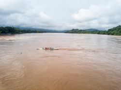 Ferries taking people and vehicles across the Mekong River.