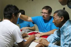 Balboa, Panama :: Simon Hutegger (Austria) gives sight tests in a shelter for male migrants.