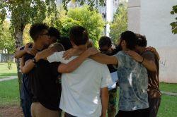 Teens huddle together at TeenStreet Balkan 2018.